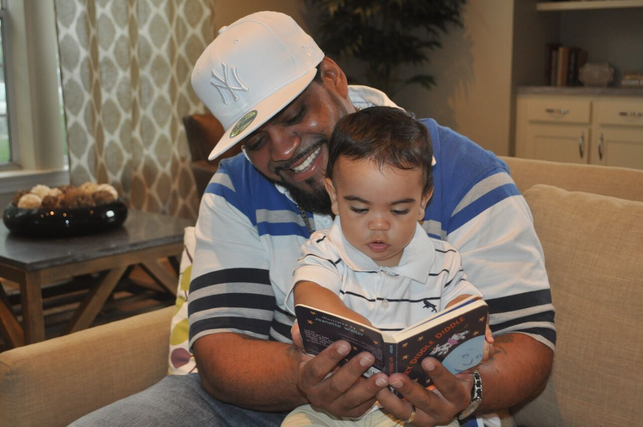 Dad and son reading